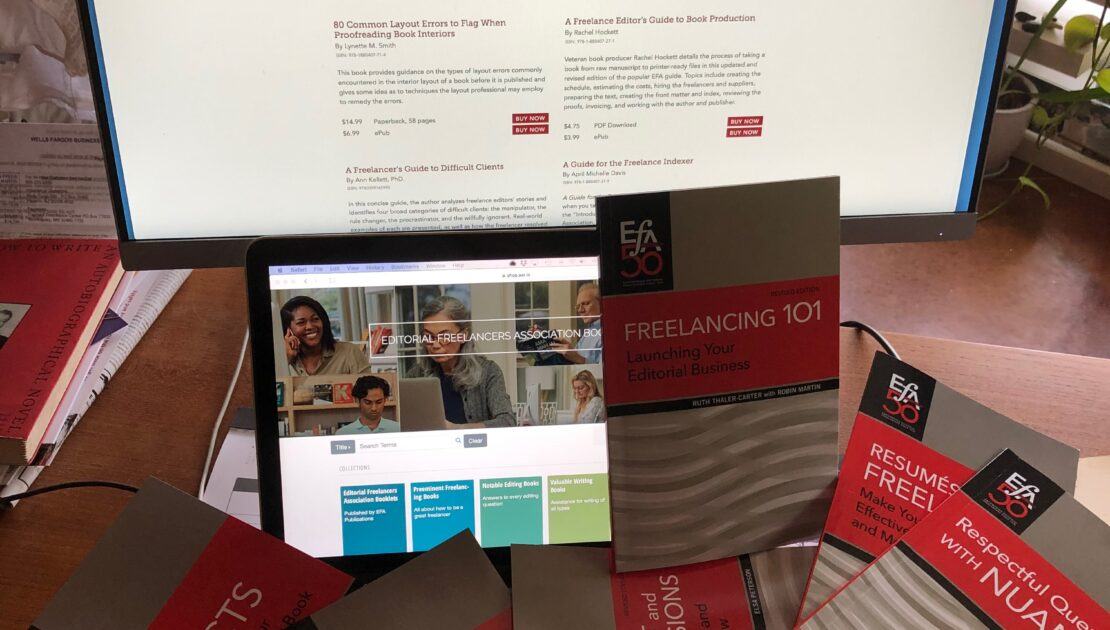 EFA Booklets on desk, monitors show EFA bookstore and booklets pages